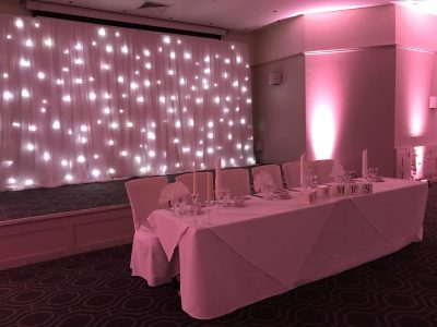 Lighting and star cloth backdrop wedding Cheshire